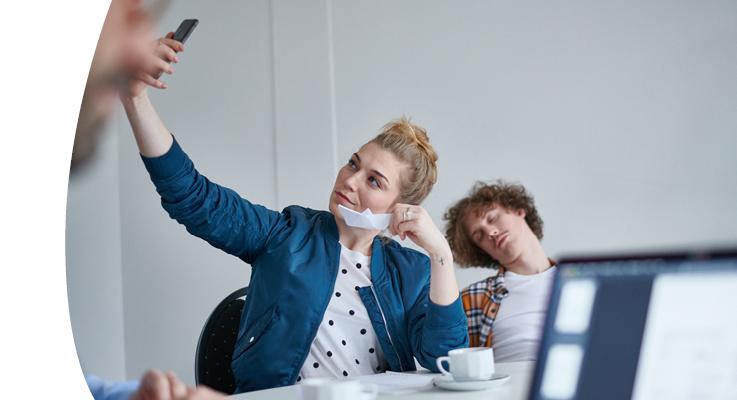Women with smartphone in meeting